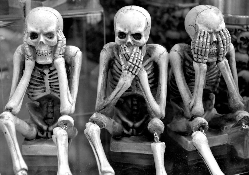 Three skeletons thinking of funny skeleton puns