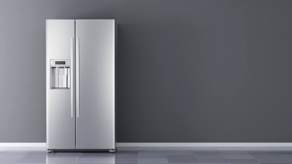 A refrigerator with fridge puns and jokes written on the side