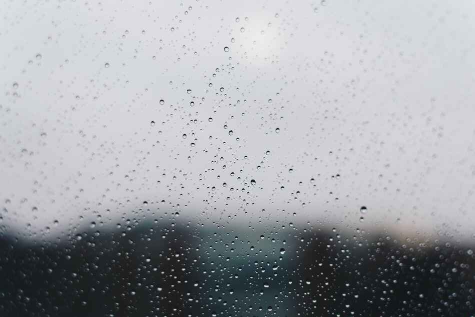 First person perspective of looking out the window while thinking of rain jokes and puns