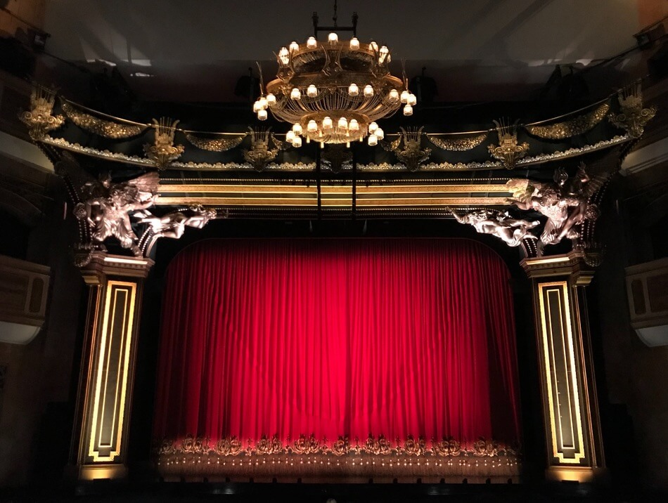 A stage before a show of theatre puns and jokes