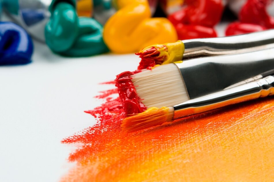 A paintbrush after drawing illustrations for art puns and art jokes