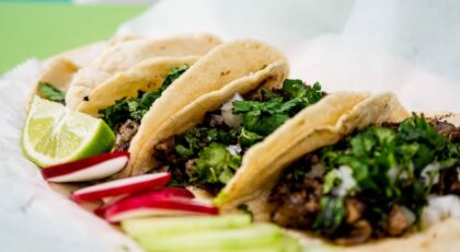 Tacos being served while people share taco puns and jokes