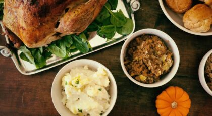 A table of food where people are sharing Thanksgiving jokes and puns